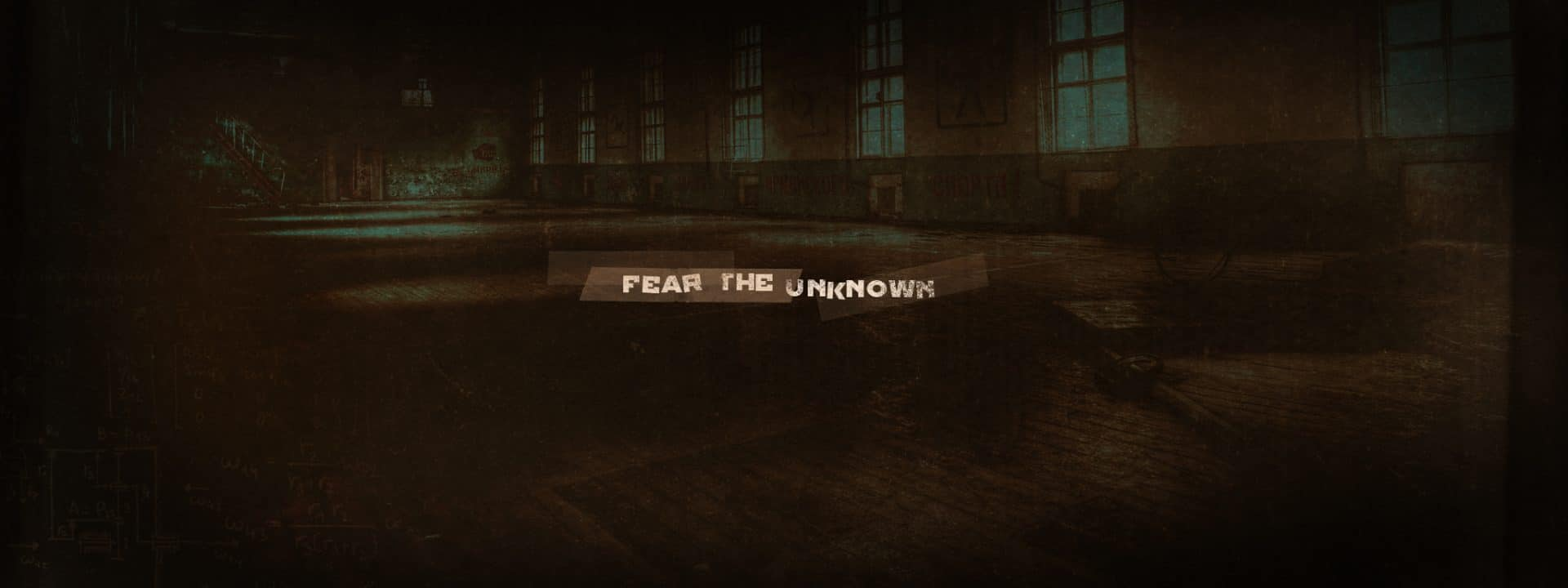Titre « fear the unknown » sur fond d'école désaffectée